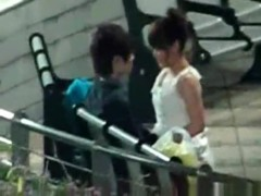 Voyeur tapes an asian girl couple having sex on a bench in the park