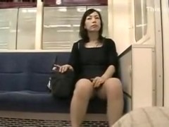 Sitting in the subway and spying on hot Japanese chick in short skirt
