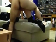 Dakr haired girl with boots and stockings has doggystyle and missionary sex on the sofa