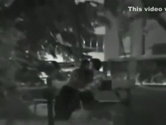 Voyeur tapes a girl sucking and jerking her bf's cock on a bench in the park