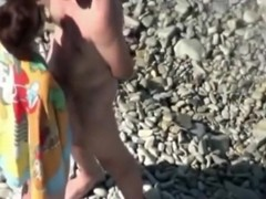 Voyeur tapes a mature couple having sex in public at the beach