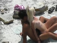Voyeur tapes a young nudist couple fucking at the beach