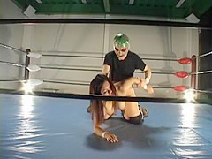Busty hairy Jap banged in a wrestling ring