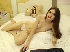 Naked beauty Milla_Jo lies on a bed