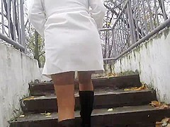 Girl flashing tan stockings going upstair