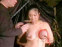 BDSM Asian gets hot wax on her pussy dmvideos