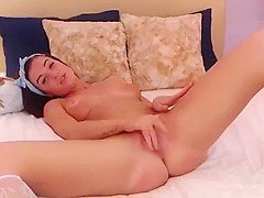 Naked CandyLoVee lies on a bed