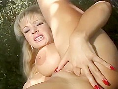 Busty MILF Tanya Does Herself In Yard