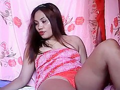 Mature filipina rubs her pussy thru her sexy panties then plays til she cums.