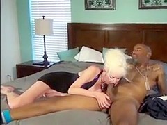Blonde granny plays with black grandpa