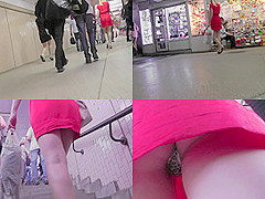 Amateur blonde shows off g-string in candid upskirts