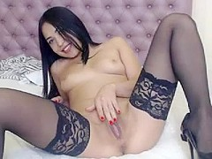 Buxom camgirl in fishnet stockings knows how to reach orgasm on her own