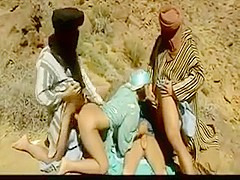 Three arabs fucks hot arabianslut in desert .