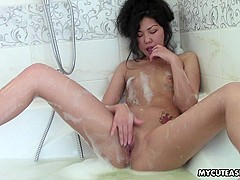 Miranda in Dark haired Chinese babe poses in tub - MyCuteAsian