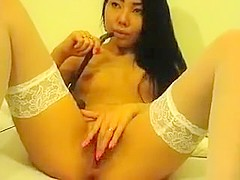 Brunette AsianSugarBabe masturbates and fucks herself with a dildo