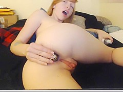 Red-haired beauty Jewel playing with her ass