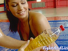 Oiledup babes wrestle and scissor each other