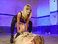 Mistress fucks slave with strapon.