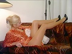 Sultry Blonde Wearing Stockings Dances