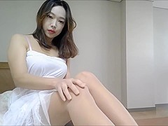 Korean girl caressing her legs for my request