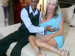 Busty blonde milf with black horny guy enjoying his big cock in her mouth and rides it greedily