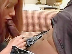 Sexy hot blonde sucking on black cock and rides it passionately
