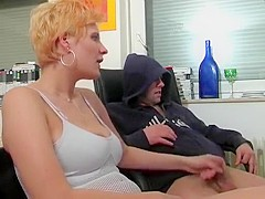 She jerks off her stepbro while watching porno