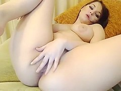 Sexy brunette babe fingering her tight pussy and teasing on webcam