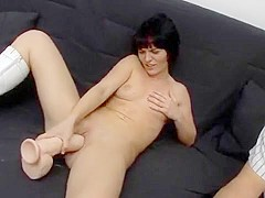 Chick plays with a rubber dick for money
