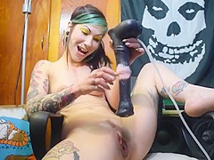 Tattooed girl has a lot of fun on the office chair