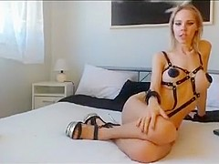 MILF clad in leather straps rides dick in the ass