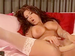 Super busty beauty pleasures herself with a dildo on livecam
