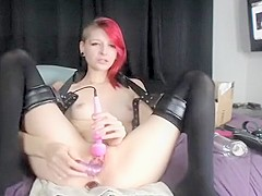 Bitch with red hair plugs dildo in her ass and plays with pussy on webcam