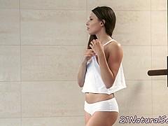 Smalltit model masturbating in solo action