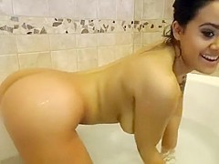 Sexy brunette babe in bathtub teasing with her hot tits and pussy