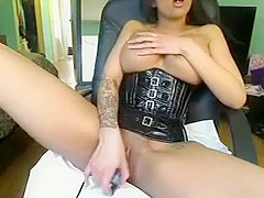 Busty brunette babe with nice big boobs stripteasing and seducing on webcam