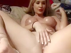 Webcam blonde with big boobs teasing and fingering her pussy
