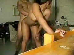Black couple having a bend over doggy at home