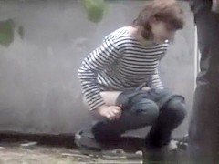 Woman caught peeing in the back of old place