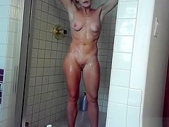 Woman shower and shaves her legs
