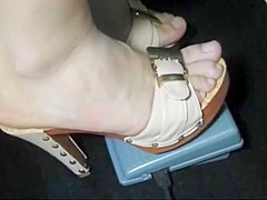 Bare feet in open high heels 12