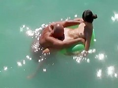 Nudist woman pussy eaten in the water