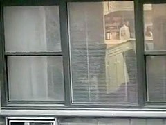 Topless neighbor girl in a window peep
