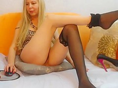Milf plays with nylon feet on webcam