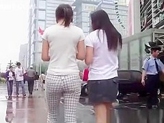 Asian chicks walking in the street