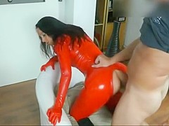 Brunette fucked in shiny red latex catsuit with facial