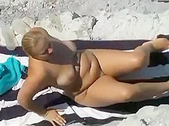 Nude milf gets out of the ocean