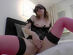 MILF fucks her pussy with a dildo