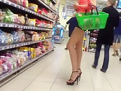 Leggy tall girl in high heals shops for food