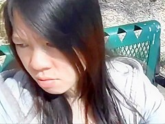 Asian girl sucking dick and swallowing at the park